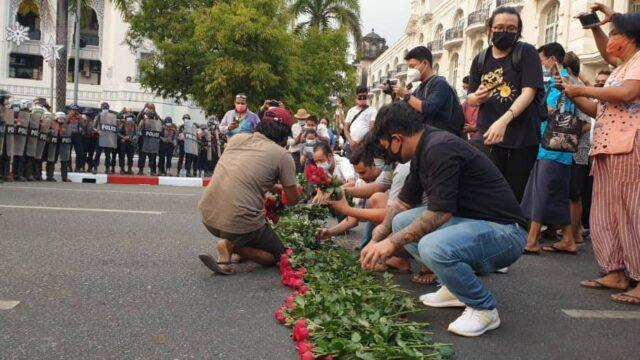 Protestors placing roses on the road