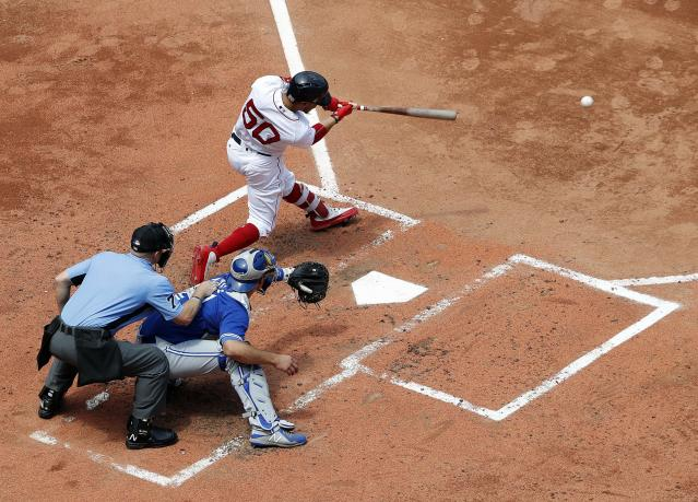 Boston Red Sox's Mookie Betts hits a single against the Toronto Blue Jays during the third inning of a baseball game Saturday, July 14, 2018, in Boston. (AP Photo/Winslow Townson)