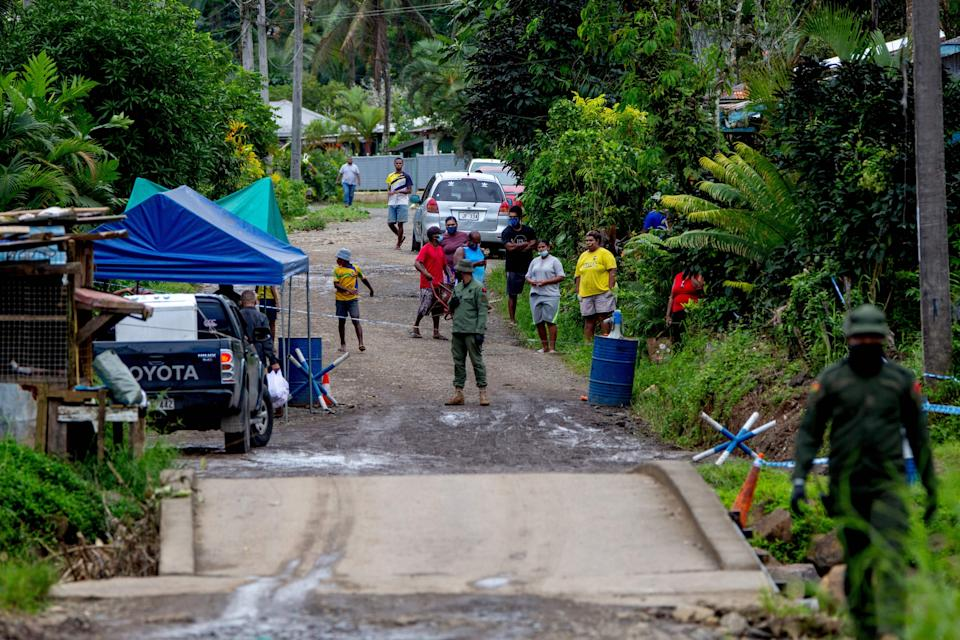 Police patrol a residential area to check people are wearing face masks in Suva on July 3, as a worsening Covid-19 outbreak overwhelms the South Pacific nation's largest hospital. Source: AFP via Getty Images)
