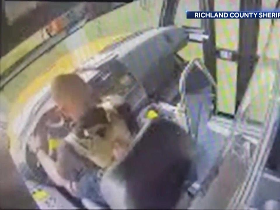 <p>CCTV footage showing a hijacking of a school bus in South Carolina on Thursday</p> (Richland County Sheriff's Department)