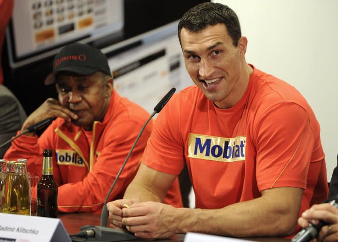Ukrainian heavyweight boxing world champion Wladimir Klitschko (R) reacts to a question sitting next to his coach , US boxing trainer Emanuel Steward (L) at a press conference after defeating French challenger Jean-Marc Mormeck in the IBF, IBO, WBO and WBA title bout at the Esprit arena in the western German city of Duesseldorf on March 3, 2012. It was Klitschko's 50th knock out victory.  AFP PHOTO / ODD ANDERSEN