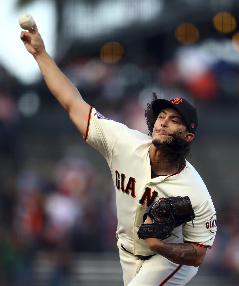 San Francisco Giants pitcher Dereck Rodriguez throws to a Miami Marlins batter during the first inning of a baseball game Tuesday, June 19, 2018, in San Francisco. (AP Photo/Ben Margot)