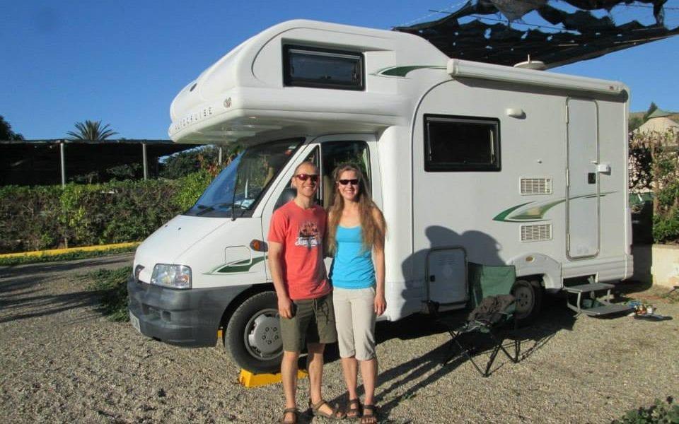 Ms Dingley is pictured with Mr Colgate as they set off in their European tour in 2014, pictured with their camper van which they nicknamed 'Homer' - Facebook