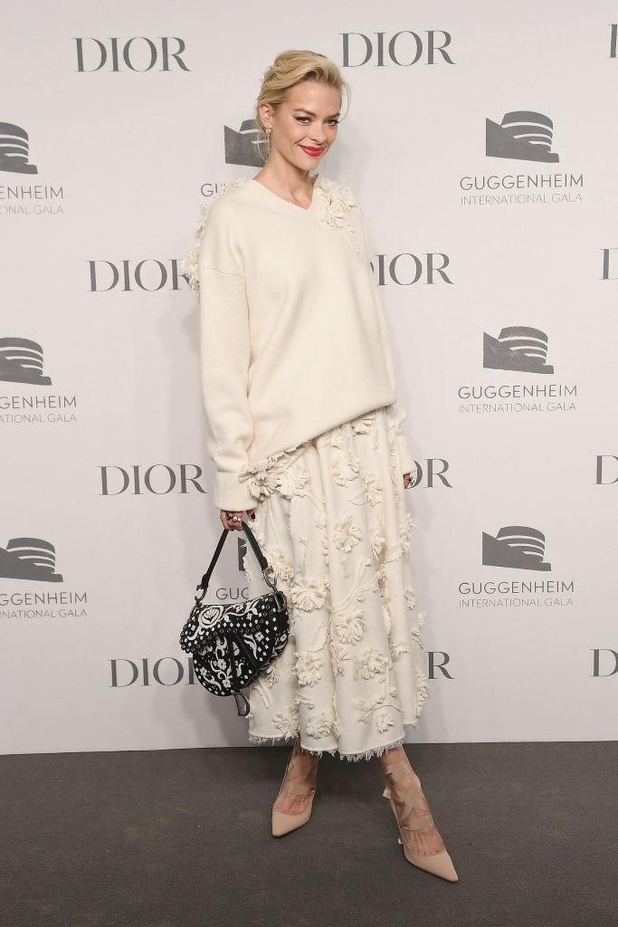 <p>Jaime King demonstrated how to work knitwear at an evening event on November 14. The actress teamed the cream-hued jumper with a ruffled skirt and *that* Dior saddle bag. <em>[Photo: Getty]</em> </p>