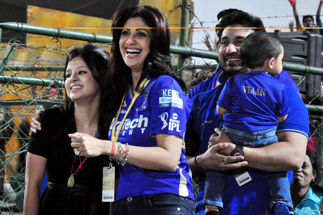 Rajasthan Royals owner Raj Kundra and Shilpa Shetty with Sakshi, wife of MS Dhoni during the match between Chennai Super Kings and Rajasthan Royals at Sawai Mansingh Stadium, Jaipur on May 12, 2013. (Photo: IANS)