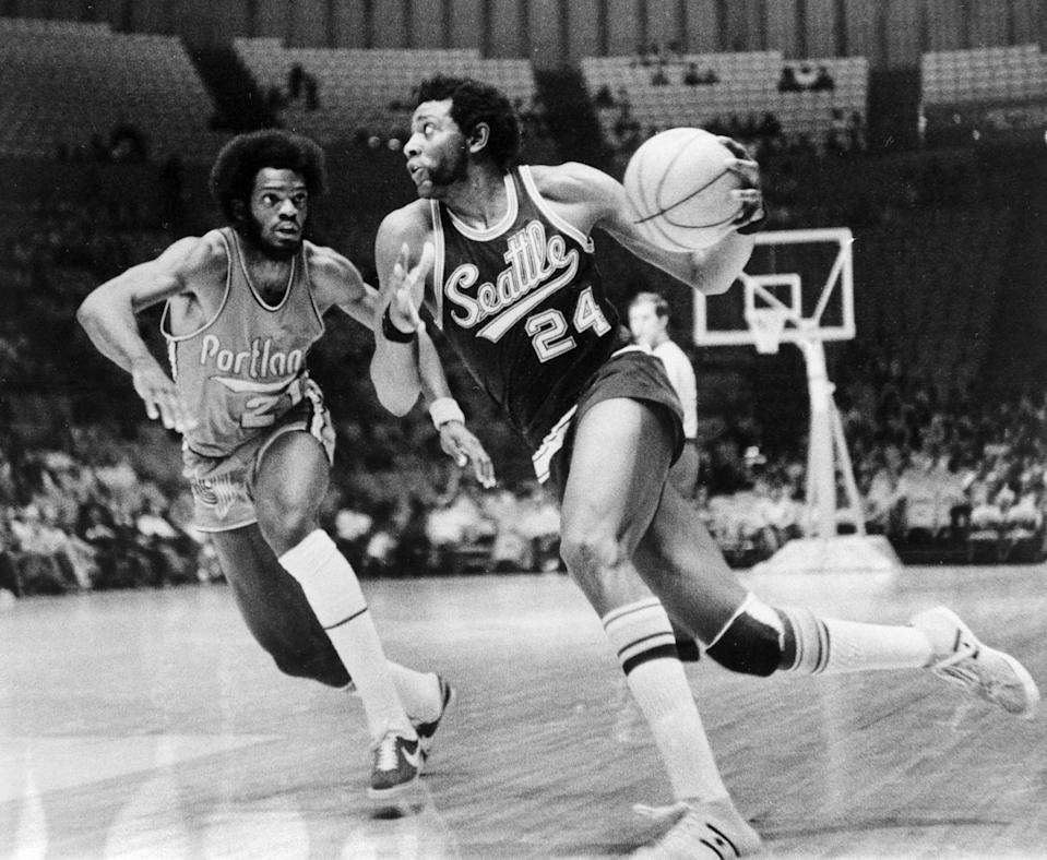 Seattle's Spencer Haywood dribbles around Portland's Sidney Wicks during a game on Oct. 7, 1972.