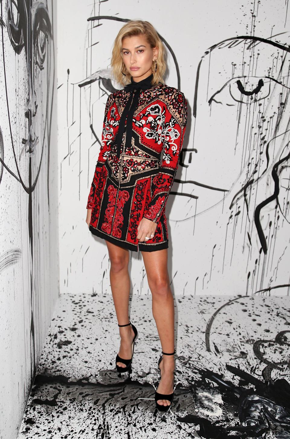 <p>The model wore an embroidered mini dress by the French fashion house. <em>[Photo: Rex]</em> </p>