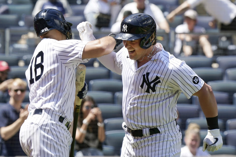New York Yankees' Rougned Odor (18) greets Luke Voit after Voit hit a solo home run during the third inning of a baseball game against the Kansas City Royals, Thursday, June 24, 2021, at Yankee Stadium in New York. (AP Photo/Kathy Willens)