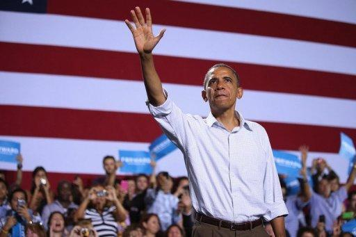 US President Barack Obama waves to supporters at a campaign rally September 8, 2012 in Kissimmee, Florida. Obama was to woo Florida voters Sunday after Republican Mitt Romney thrust religion to the center of the White House race as he sought to underscore the rivals' different approach to traditional values
