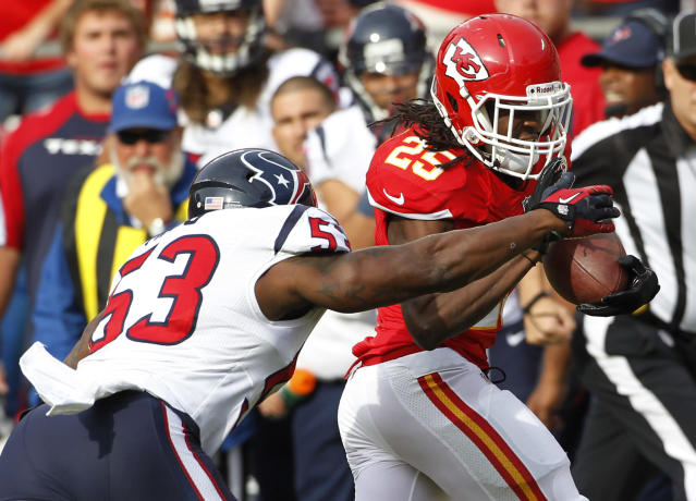 Kansas City Chiefs running back Jamaal Charles (25) is tackled by Houston Texans inside linebacker Joe Mays (53) during the first half of an NFL football game at Arrowhead Stadium in Kansas City, Mo., Sunday, Oct. 20, 2013. (AP Photo/Colin E. Braley)