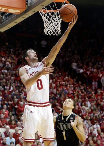 Indiana forward Will Sheehey (0) gets a bucket over Purdue guard Anthony Johnson in the second half of a NCAA college basketball game in Bloomington, Ind., Saturday, Feb. 16, 2013. Indiana defeated Purdue 83-55. (AP Photo/Michael Conroy)