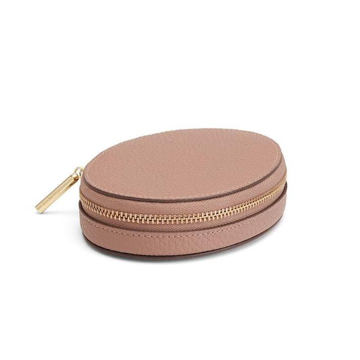"""<p><strong>Cuyana </strong></p><p>cuyana.com</p><p><strong>$85.00</strong></p><p><a href=""""https://go.redirectingat.com?id=74968X1596630&url=https%3A%2F%2Fwww.cuyana.com%2Fsmall-leather-goods%2Fcases%2Ftravel-jewelry-case%2F10051041-642-000.html&sref=https%3A%2F%2Fwww.veranda.com%2Ftravel%2Fg37080014%2Ftravel-essentials%2F"""" rel=""""nofollow noopener"""" target=""""_blank"""" data-ylk=""""slk:Shop Now"""" class=""""link rapid-noclick-resp"""">Shop Now</a></p><p>Packing your jewelry is easy when the container is as pretty as this beautiful pebbled leather case. </p>"""