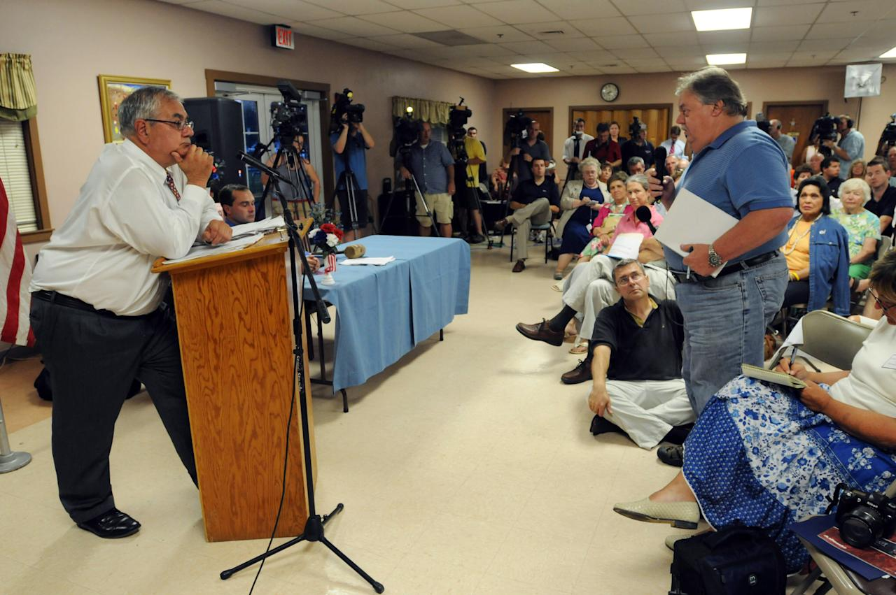 DARTMOUTH, MA - AUGUST 18:   United States Representative Barney Frank (D-MA) listens to a question during a town hall meeting August 18, 2009 at the Dartmouth Council on Aging in Dartmouth, Massachusetts. Frank, chairman of the House Financial Services Committee, accepted an invitation from the Democratic Town Committee of Dartmouth to speak on the major issues before Congress including healthcare reform and efforts to curb the abuses in the financial industry. (Photo by Darren McCollester/Getty Images)