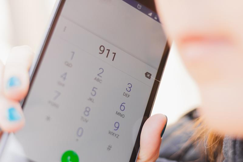 Closeup shot of phone display with the number 911 dialed