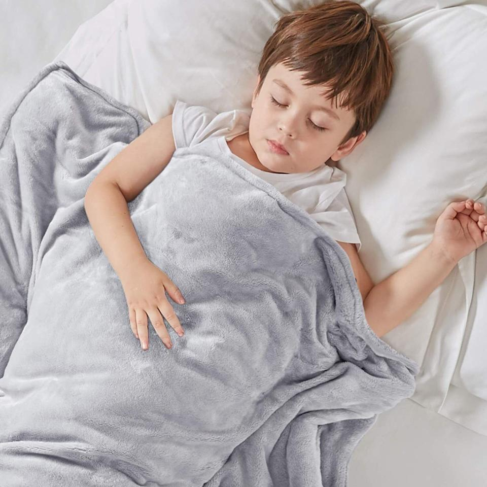 """Itcomes with two divet covers — one is a cozy fleece and the other is made of a CoolMax Microfiber technology that can help ventilate heat away from your body.<br /><br /><strong>Promising review:</strong>""""This blanket is wonderful! I was always curious to try a weighted blanket but was skeptical if they actually worked. After reading reviews, I thought I'd give it a try. I am so glad I did. I was having a hard time falling asleep and staying asleep. After receiving this blanket, my sleep has improved dramatically and I stay asleep most of the night. I like the option of having the cooling duvet and the warmer one. I am a hot sleeper so I stick with the cool one. The only downside to the blanket is changing the duvets you have to tie countless pieces together for it to stay in place but other than that this blanket is sooo worth it!!"""" — <a href=""""https://www.amazon.com/gp/customer-reviews/R40U77WO3RITT?&linkCode=ll2&tag=huffpost-bfsyndication-20&linkId=6ccfa787153661fa5a145689e3f5ebb9&language=en_US&ref_=as_li_ss_tl"""" target=""""_blank"""" rel=""""noopener noreferrer"""">Emma</a><br /><br /><strong><a href=""""https://www.amazon.com/Degrees-Comfort-Weighted-Nano-Ceramic-Durability/dp/B07RXMDM81?th=1&linkCode=ll1&tag=huffpost-bfsyndication-20&linkId=29e1208624381c9d595838875a30d595&language=en_US&ref_=as_li_ss_tl"""" target=""""_blank"""" rel=""""noopener noreferrer"""">Get it from Amazon for $42.99(available in 14 sizes and six colors).</a></strong>"""
