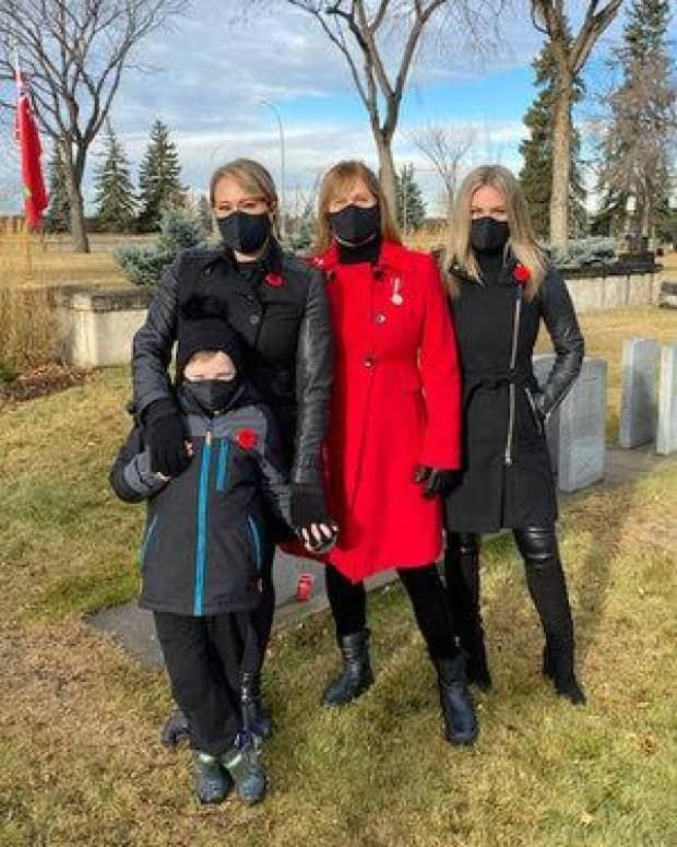 Maureen Bianchini Purvis with her daughters and grandson at Edmonton's Beechmount Cemetery in November 2020.
