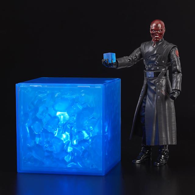 "You and Red Skull can have matching Cosmic Cubes. The life-size version of the Tesseract features light effects and a hidden battery compartment, and the ""Marvel Legends"" figure features detailed sculpting and full articulation. (Photo: Hasbro)"
