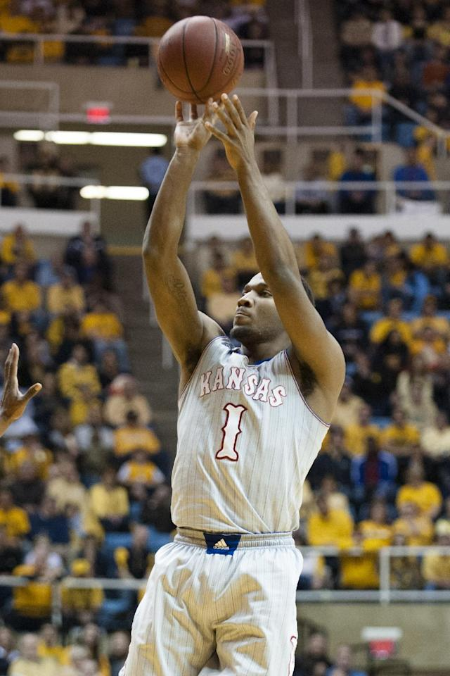 Kansas' Wayne Selden, Jr. (1) shoots during the first half of an NCAA college basketball game against West Virginia, Saturday, March 8, 2014, in Morgantown, W.Va. (AP Photo/Andrew Ferguson)