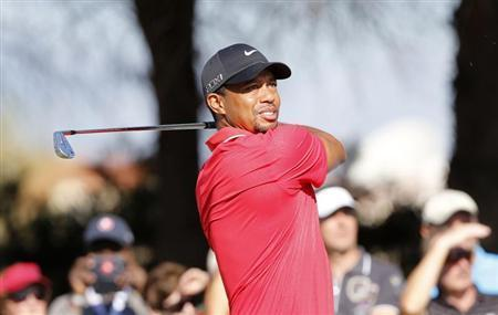 Tiger Woods of the U.S. tees off on the 5th hole during the final round of the inaugural Turkish Airlines Open in the south west city of Antalya November 10, 2013. REUTERS/Umit Bektas