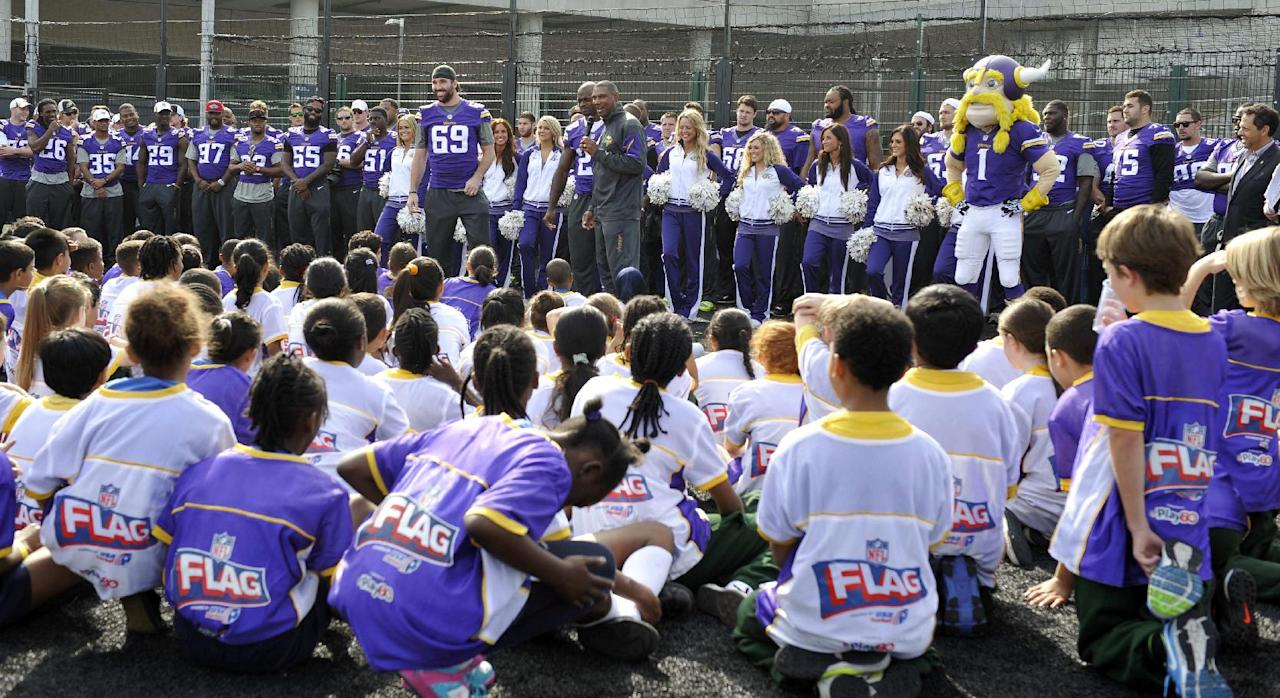 Head coach of the Vikings Leslie Frazier addresses the children during a coaching clinic with London children near Wembley Stadium, London, Tuesday Sept. 24, 2013. The Pittsburgh Steelers are to play the Minnesota Vikings in the NFL International Series at Wembley Stadium in London on Sunday, Sept 29. (AP Photo/Sean Ryan, NFL)