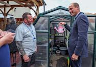 <p>Prince William gets ready to do some work on Thursday while visiting Brighter Futures — a group of organizations that support children and families — in Rhyl, Wales. </p>