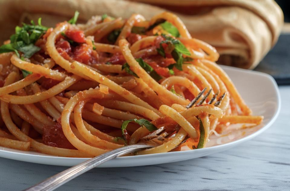 Bucatini amatriciana pasta with basil fork