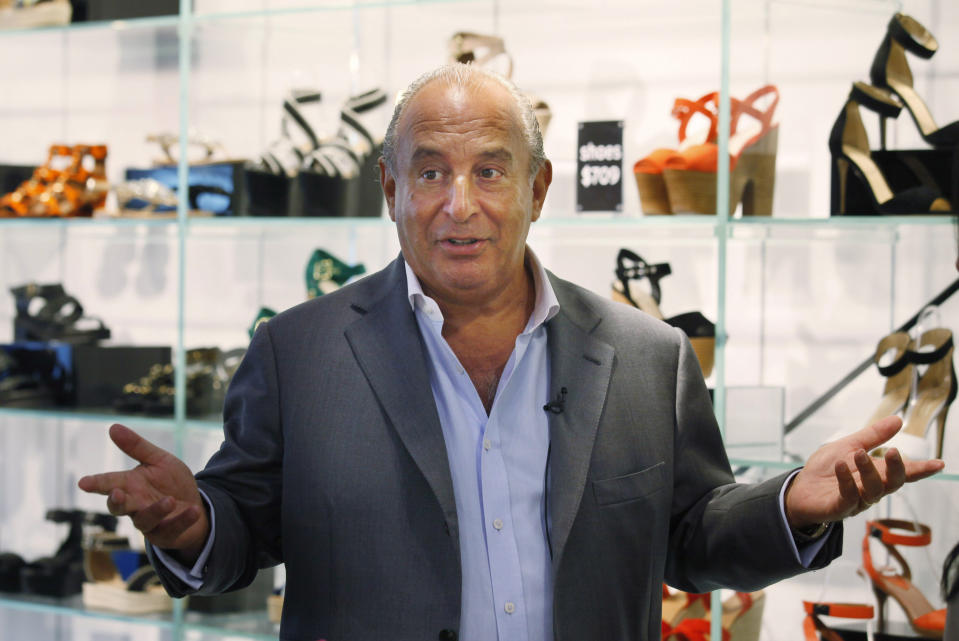 "In this Wednesday, June 5, 2013 photo, Topshop boss Philip Green speaks at his new Topshop store in Hong Kong. British fashion chain Topshop is opening its first Hong Kong outlet on Thursday, becoming the latest Western brand to brave the city's high rents in a bid to crack the lucrative China market. Topshop boss Philip Green said he wants to use the store as a ""stepping stone"" to mainland China. He's looking for possible locations in Beijing and Shanghai to open ""flagship"" stores.  (AP Photo/Kin Cheung)"