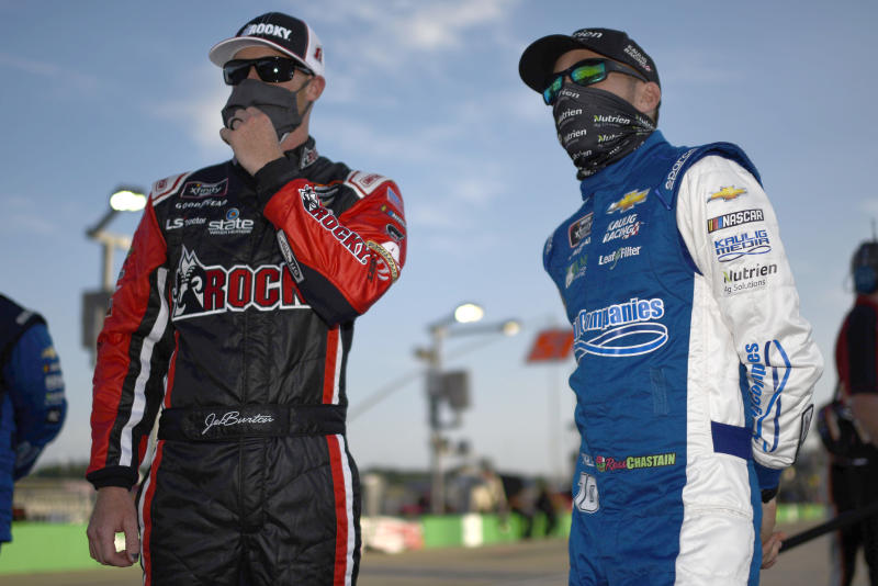 SPARTA, KENTUCKY - JULY 09: Jeb Burton, driver of the #8 Rocky Boots Chevrolet, and Ross Chastain, driver of the #10 Chevy Accessories Chevrolet, talk on the grid prior to the NASCAR Xfinity Series Shady Rays 200 at Kentucky Speedway on July 09, 2020 in Sparta, Kentucky. (Photo by Jared C. Tilton/Getty Images)