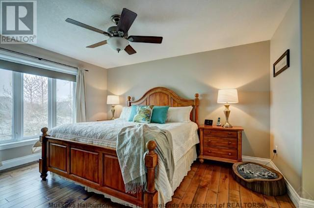 <p><span>359 Falcon Road, Huntsville, Ont.</span><br> The master bedroom has his-and-her closets and an ensuite.<br> (Photo: Zoocasa) </p>