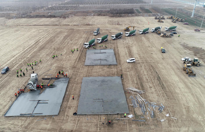 In this photo released by China's Xinhua News Agency, workers begin to build a medical isolation site that, according to state media, will cover 33 hectares and have room for several thousand people in Shijiazhuang in northern China's Hebei Province, Thursday, Jan. 14, 2021. China has put more than 20 million people under varying degrees of lockdown in Hebei, Beijing and other areas in hopes of stemming infections ahead of next month's Lunar New Year holiday. (Yang Shiyao/Xinhua via AP)