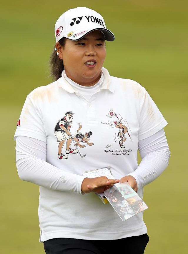 South Korea's Sun Ju Ahn finishes her round as the leader on the third day of the Women's British Open golf championship on the Royal Birkdale Golf Club, Southport, England, Saturday July 12, 2014. (AP Photo/Scott Heppell)
