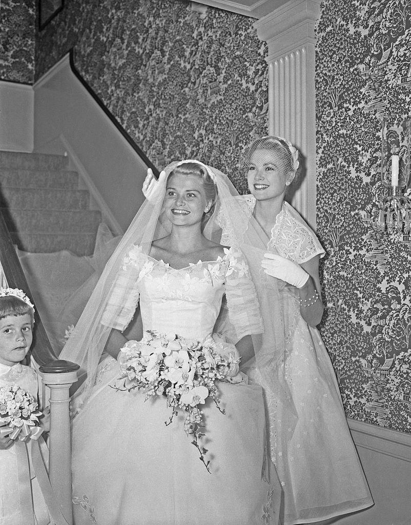 <p>Kelly returned to her family home in Philadelphia, Pennsylvania, in 1955 for her sister Anne's wedding. The film star took a step back from the spotlight and dutifully helped with her sister's veil, as they left for the church ceremony. </p>