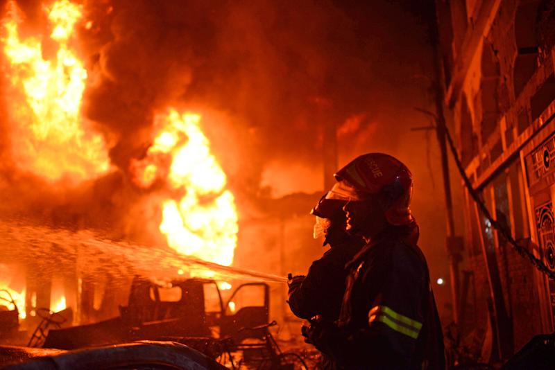 Firefighters try to douse a fire in Dhaka, Bangladesh, Feb. 20, 2019. A devastating fire raced through at least five buildings in an old part of Bangladesh's capital and killed scores of people. (Photo: AP)