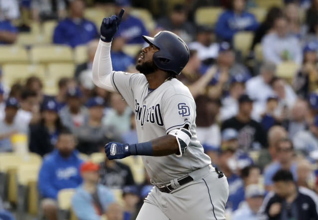San Diego Padres' Franmil Reyes points skyward after hitting a solo home run against the Los Angeles Dodgers during the first inning of a baseball game Tuesday, May 14, 2019, in Los Angeles. (AP Photo/Marcio Jose Sanchez)