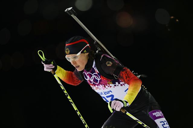 """FILE - In this Feb. 17, 2014 file photo, Germany's Evi Sachenbacher-Stehle skis during the women's biathlon 12.5k mass-start, at the 2014 Winter Olympics, in Krasnaya Polyana, Russia. German Olympic officials said Sachenbacher-Stehle has been kicked out of the Sochi Games after a positive doping test. The German Olympic Committee said she tested positive on Monday, Feb. Feb. 17, for the stimulant methylhexanamine. Both the """"A'' sample and backup """"B'' sample were positive. The committee said the athlete has been removed from the team and is being sent home. (AP Photo/Felipe Dana, File)"""