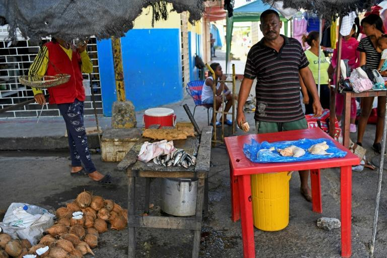 Residents and traders from the Venezuelan port town of Guiria travel to Trinidad and Tobago by boat, risking their lives, to stock up on flour, rice, oil and other essentials that have become scarce and prohibitively expensive at home