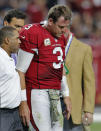 Arizona Cardinals quarterback Carson Palmer (3) leaves after injuring his left knee during the second half of an NFL football game against the St. Louis Rams, Sunday, Nov. 9, 2014, in Glendale, Ariz. (AP Photo/Rick Scuteri)