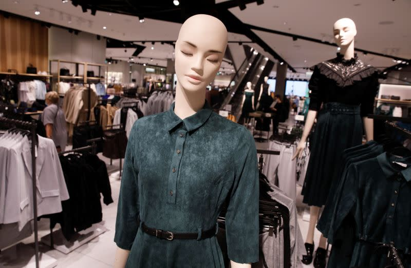 Clothes are displayed on the mannequins at Polish fashion retailer LPP brand Reserved shop in Warsaw