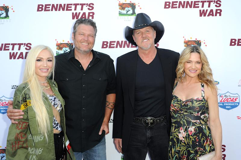 Gwen Stefani (from left), Blake Shelton, Trace Adkins and Victoria Pratt attend the Los Angeles premiere of