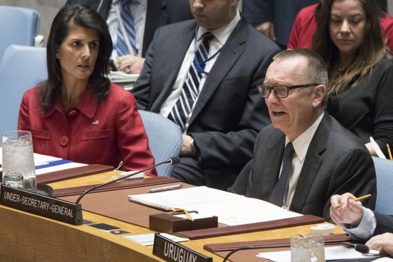 United States' Ambassador United Nations and and Security Council President Nikki Haley, left, listens as United Nations Under-Secretary-General for Political Affairs Jeffrey Feltman speaks during a Security Council meeting on the situation in Syria, Friday, April 7, 2017 at United Nations headquarters. (AP Photo/Mary Altaffer)