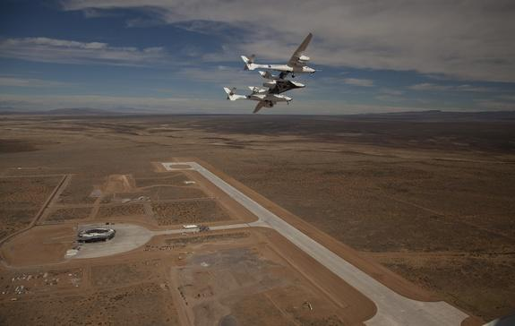 Early flyover of New Mexico's Spaceport America by the WhiteKnightTwo/SpaceShipTwo launch system.