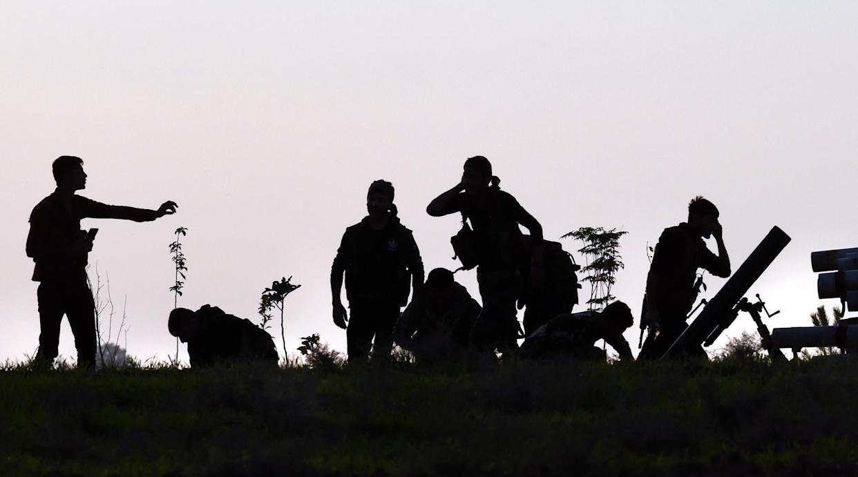 November 2, 2019, Tel Tamir, Syria: Kurdish YPG soldiers fight Turkish forces on a road near the front line. The humanitarian group Free Burma Rangers stood by for rescue operations. During one rescue they defended from fierce gunfire, 6 tank rounds and an RPG attack to rescue a soldier with internal injuries. (Photo: ©Carol Guzy/ZUMA Wire)
