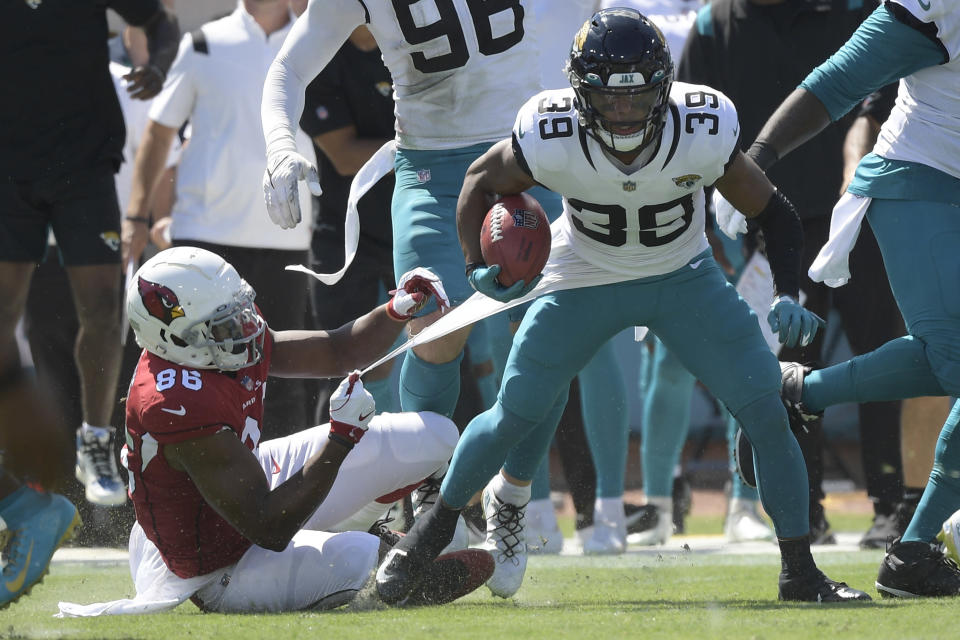 Jacksonville Jaguars wide receiver Jamal Agnew (39) gets away from Arizona Cardinals tight end Demetrius Harris (86) on his way to a 109-yard touchdown run on a missed field goal by the Arizona Cardinals during the first half of an NFL football game, Sunday, Sept. 26, 2021, in Jacksonville, Fla. (AP Photo/Phelan M. Ebenhack)