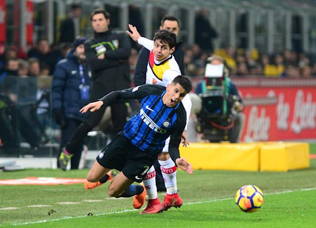 Soccer Football - Serie A - Inter Milan vs Benevento Calcio - San Siro, Milan, Italy - February 24, 2018 Inter Milan's Joao Cancelo in action with Benevento's Guilherme REUTERS/Massimo Pinca