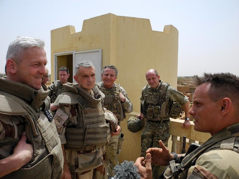 General Lecointre (L) meets troops in Menaka. French and British chiefs of staff are in Mali to highlight their shared fight against jihadism in the country