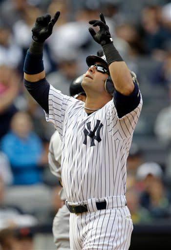 New York Yankees' Nick Swisher reacts after hitting a solo home run off Detroit Tigers starting pitcher Drew Smyly during the first inning of a baseball game on Saturday, April 28, 2012, in New York. (AP Photo/Julio Cortez)