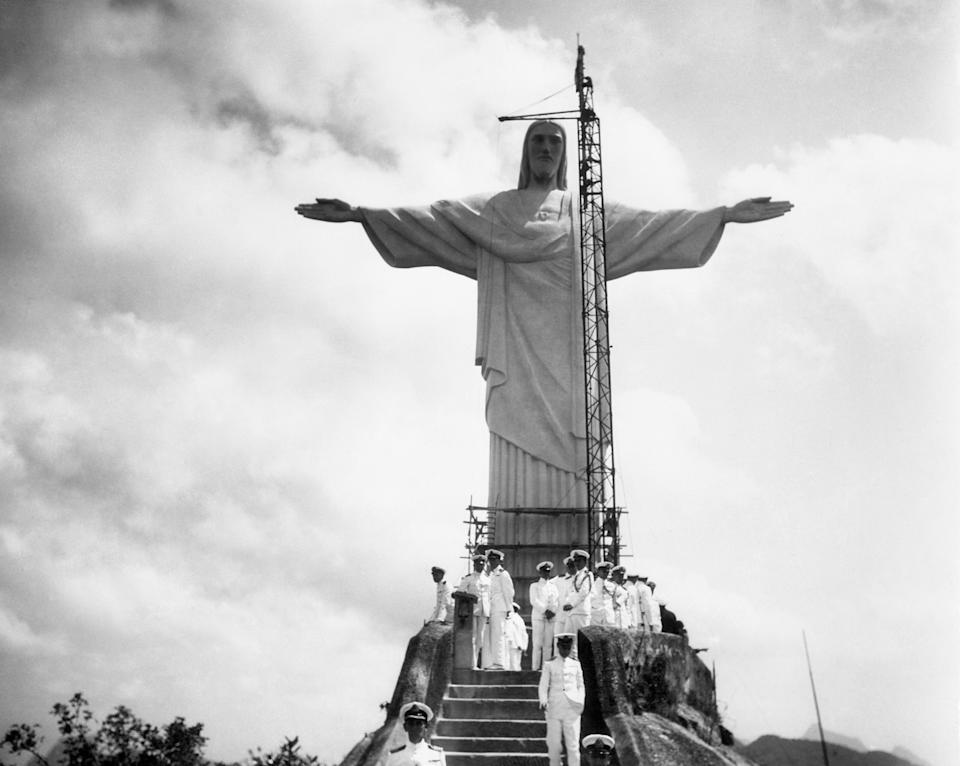 An airplane view of the great religious shrine on the crest of the Corcovado new Rio De Janerio and placed some 2100 feet above sea level. The statue is 130 feet high, nearly the size of the great Statue of Liberty in New York Harbor. This shrine will be officially unveiled on October 12, 1931. The only other larger statue in the western world is the