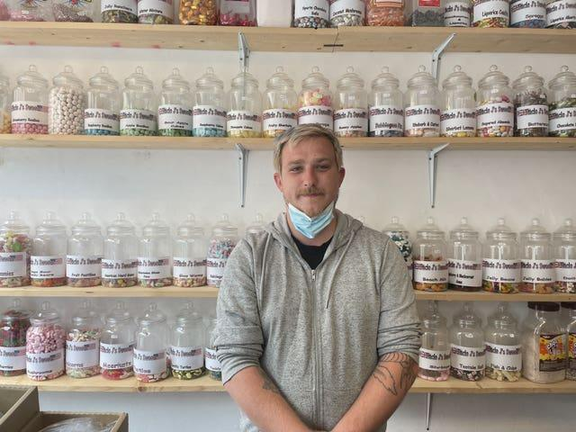 Clinton Matthews, owner of J's Sweets, inside his shop in St Ives during the G7 summit in Cornwall