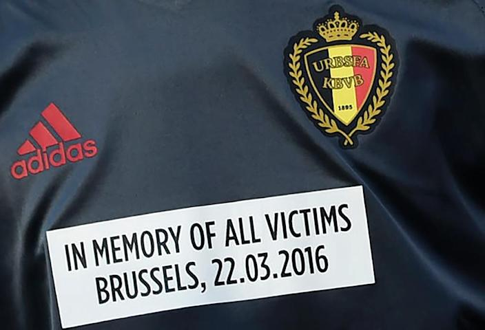A Belgian player sports a sticker on his jersey to pay tribute to Brussels attacks victims, before a friendly international against Portugal in Leiria, Portugal (AFP Photo/Francisco Leong)
