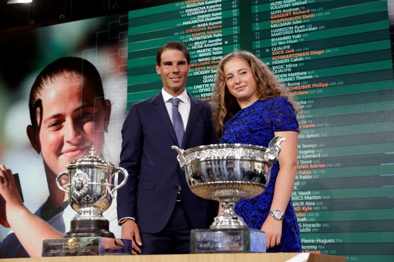 Champions return: Rafael Nadal and Jelena Ostapenko with their French Open trophies at Thursday's draw